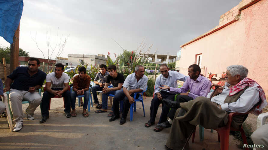Turkish Kurdish men chat in the village of Doruklu, in the border town of Silopi, near the Turkish-Iraqi border, in this picture taken July 5, 2014. What has long been a dream for the Middle East's Kurds, an independent state, is within reach in Iraq