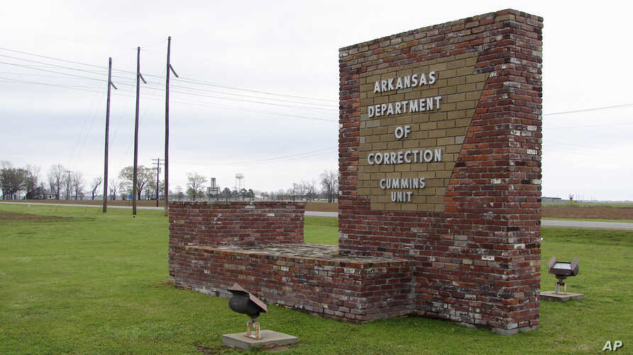 FILE - This March 25, 2017, photo shows a sign for the Department of Correction's Cummins Unit prison in Varner, Ark.
