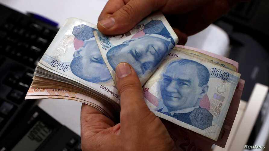 A money changer counts Turkish lira notes at a currency exchange office in Istanbul, Aug. 2, 2018. The lira has taken a beating since U.S. sanctions were applied in the case of a detained pastor, Andrew Brunson.