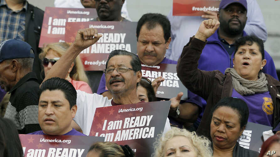 FILE - Community activists rally during an event on Deferred Action for Childhood Arrivals (DACA) and Deferred Action for Parental Accountability (DAPA) in Los Angeles, Feb. 17, 2015.
