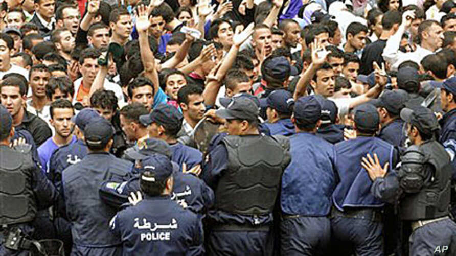 University students face police officers as they demonstrate in Algiers. Students were protesting for increased freedom, April, 11, 2011