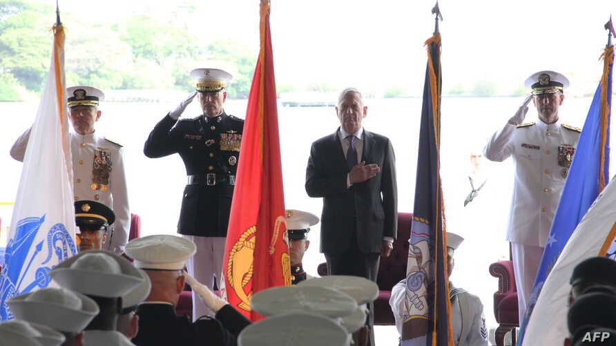 U.S. Pacific Command head Admiral Harry Harris (L); General Joe Dunford, Chairman of the Joint Chiefs of Staff (2nd L); Defense Secretary Jim Mattis and Admiral John Richardson (R) attend a change of command ceremony in Pearl Harbor, Hawaii,  May 30,