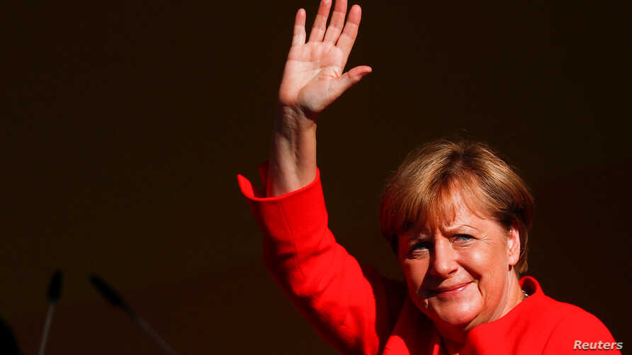 German Chancellor Angela Merkel, top candidate for the upcoming general elections of the Christian Democratic Union party (CDU), waves to supporters during an election campaign rally in Bitterfeld-Wolfen, Germany, August 29, 2017.