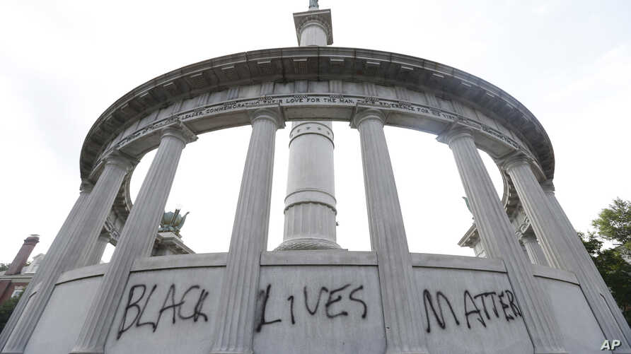 """The words """"Black Lives Matter"""" spray painted on a monument to former Confederate President Jefferson Davis in Richmond, Va., June 25, 2015."""