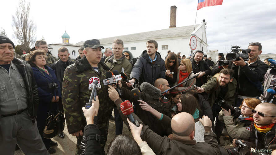 Colonel Sergei Storozhenko, commander of the military unit in the village of Perevalnoye, talks to the media outside Simferopol, March 6, 2014.