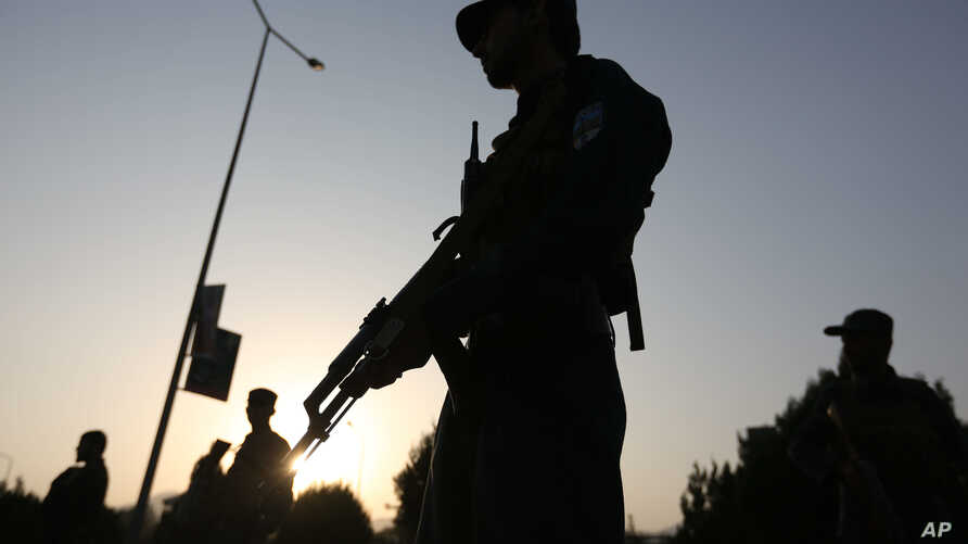 Afghan security forces stand guard after an attack on the American University of Afghanistan in Kabul, Afghanistan, Thursday, Aug. 25, 2016.