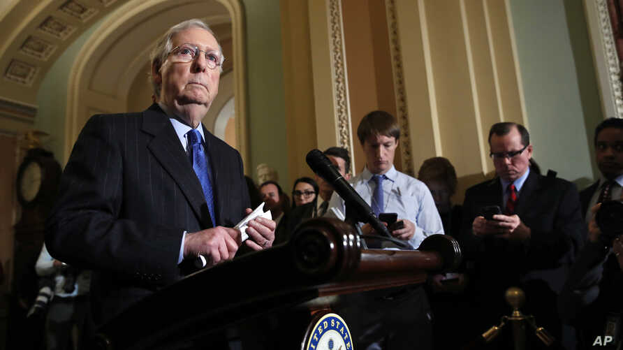 Senate Majority Leader Mitch McConnell of Kentucky listens to a question as he speaks to the media on Capitol Hill in Washington, Nov. 27, 2018.