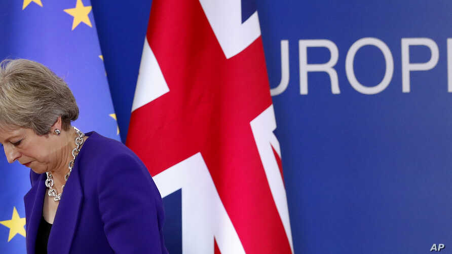 British Prime Minister Theresa May walks off the podium after a media conference during an EU summit in Brussels, Oct. 18, 2018. EU leaders met to discuss migration, cybersecurity and to try and move ahead on stalled Brexit talks.