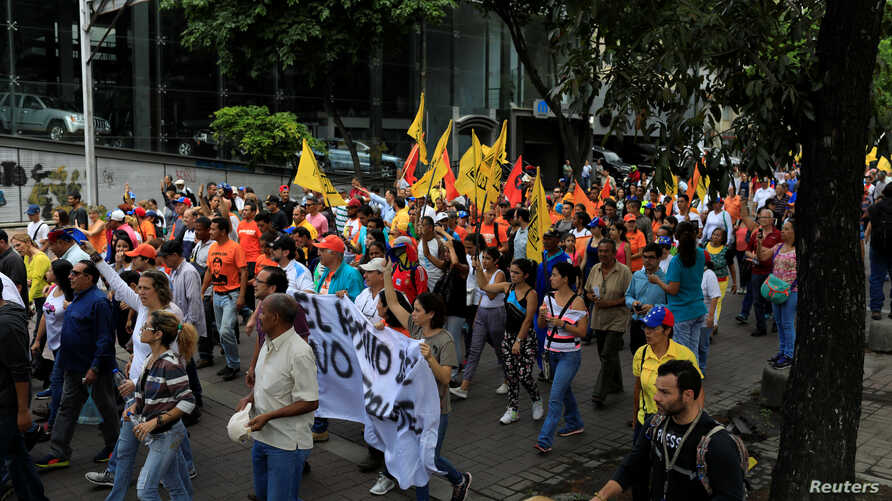 Opposition supporters take part in a protest against upcoming presidential elections, in Caracas, Venezuela, May 16, 2018.