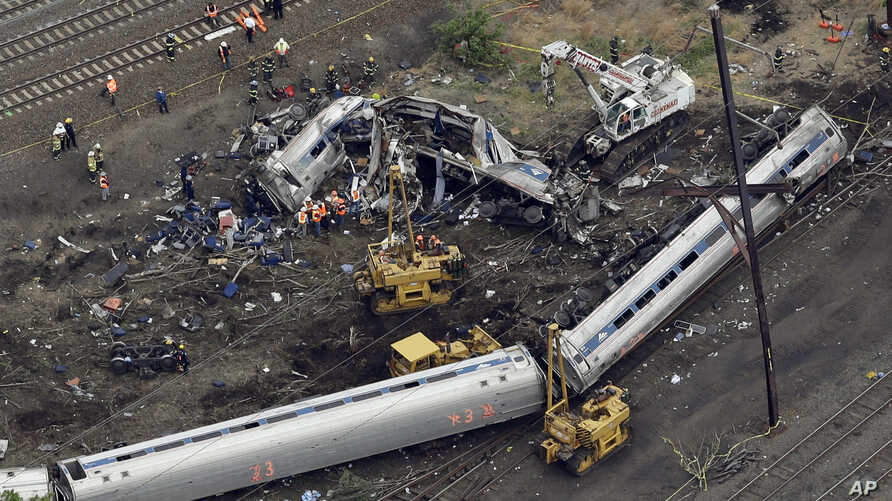 Emergency personnel work at the scene of a deadly train derailment, May 13, 2015, in Philadelphia.
