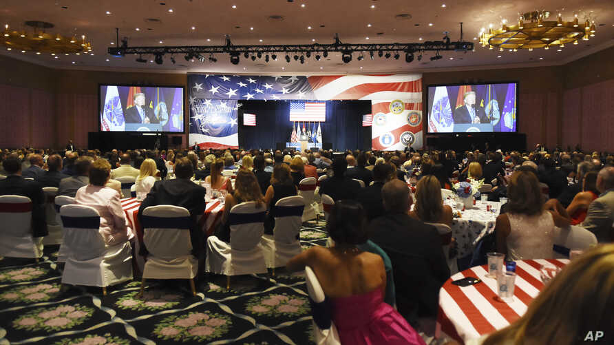 Audience members listen to President Donald Trump's remarks at a Salute to Service at a Salute to Service charity dinner in conjunction with the PGA Tour's Greenbrier Classic at The Greenbrier in White Sulphur Springs, W.Va., Tuesday, July 3, 2018.