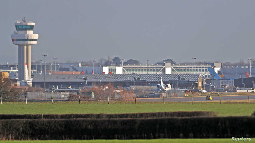 A police vehicle stands on the closed runway at Gatwick Airport after drones flying illegally over the airfield forced the closure of the airport, in Gatwick, Britain, Dec. 20, 2018.