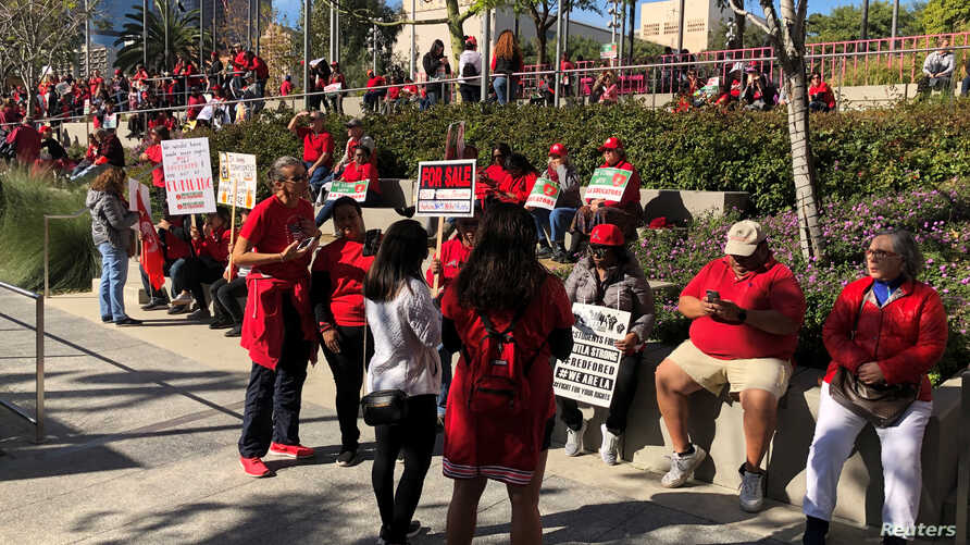 Teachers gather at Grand Park in Los Angeles for a rally after their union reached a deal with school district officials on a new proposed contract in Los Angeles, California, Jan. 22, 2019.