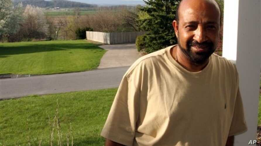 Ethiopian opposition figure Berhanu Nega, shown at his home in Pennsylvania April 25, 2099, is calling for talks with the government in Addis Ababa following the death of Prime Minister Meles Zenawi.
