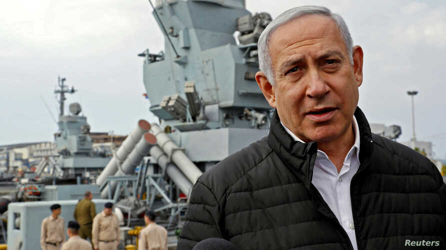 Israeli Prime Minister Benjamin Netanyahu gives a statement during his visit to a navy base in Haifa, Israel, Feb. 12, 2019.