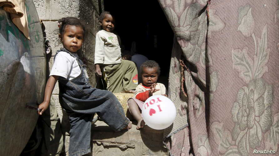 Children linger near their home in a poor neighborhood of Yemen's capital, Sanaa, Dec. 4, 2015. The NGO Human Rights Watch has condemned unlawful airstrikes that kill civilians.
