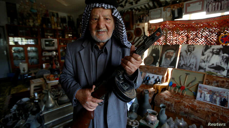 Youssef Akkar, 80, an Iraqi retired teacher poses for a picture in his museum at home in Najaf, Iraq, Feb. 21, 2019.