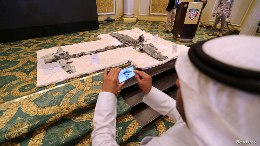 A Saudi man takes photos of Iran-aligned Houthi drones, brought down April 11, 2018, over Jizan and Abha, during a news conference in Khobar, Saudi Arabia, April 16, 2018. Saudi security forces shot down a recreational drone in the capital on Saturda