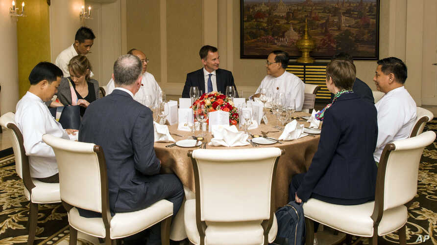 Britain's Foreign Secretary Jeremy Hunt, center, talks with government officials during a meeting on Sept. 20, 2018, in Naypyitaw, Myanmar.