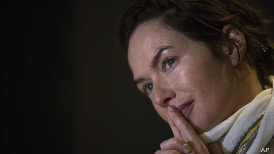 Game of Thrones star Lena Headey listens to a question during an interview with the Associated Press in Athens, on June 1, 2016.