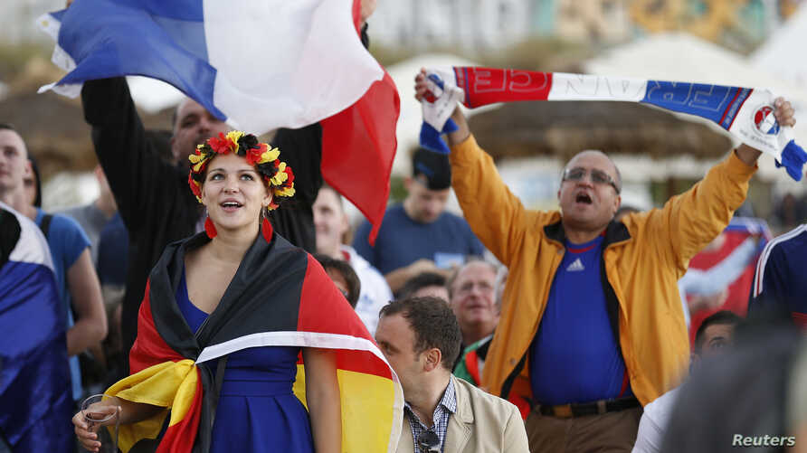 Fans watch French and German soccer teams' quarterfinal match in the border town of Kehyl, Germany, near Strasbourg, July 4, 2014.
