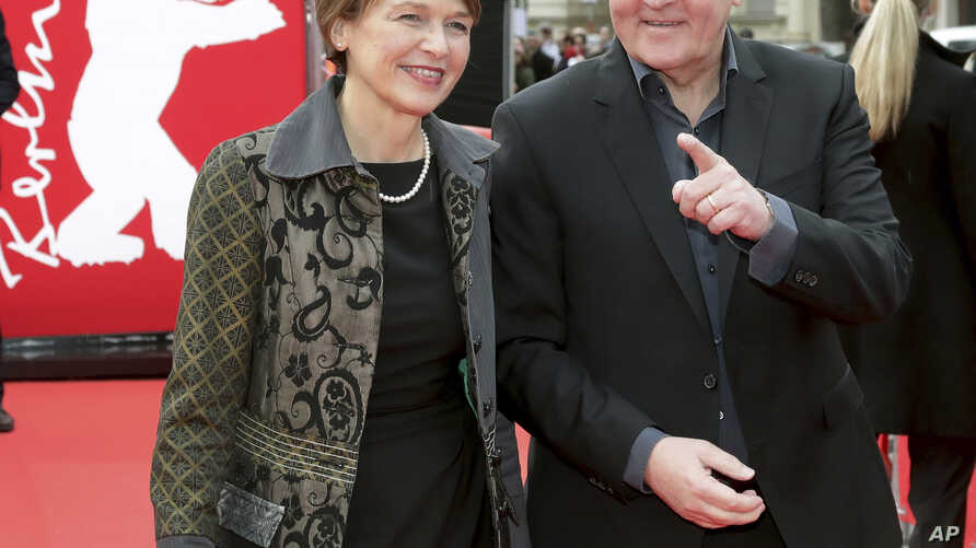 FILE - German President Frank-Walter Steinmeier (R) and his wife Elke Buedenbender pose for the media on the red carpet for the film 'Brecht' at the 2019 Berlinale Film Festival in Berlin, Germany, Feb. 9, 2019.