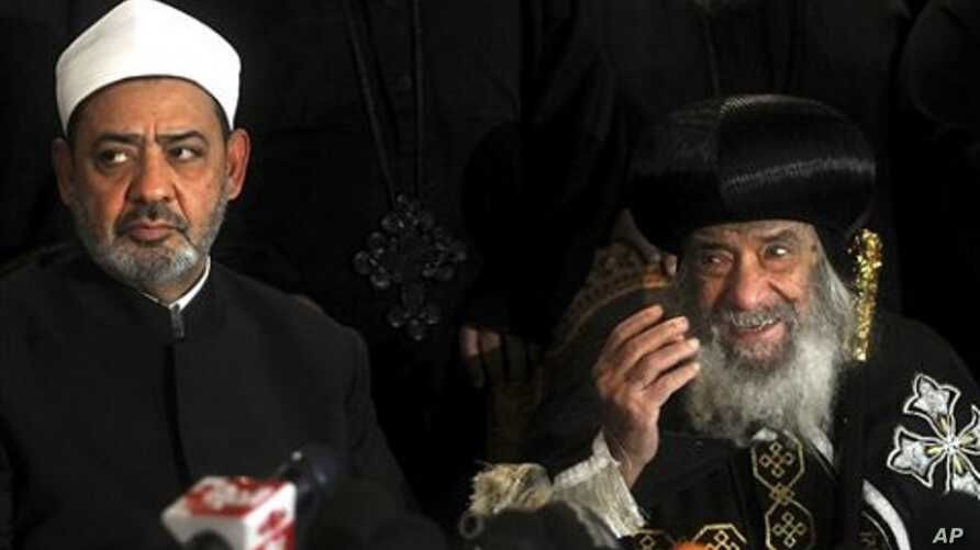 Ahmed el-Tayeb the grand sheik of Cairo's Al-Azhar, the pre-eminent theological institute of Sunni Islam, left, and Pope Shenouda III, the head of the Coptic church, talk to the media in Cairo, Egypt, Sunday Jan. 2 , 2011