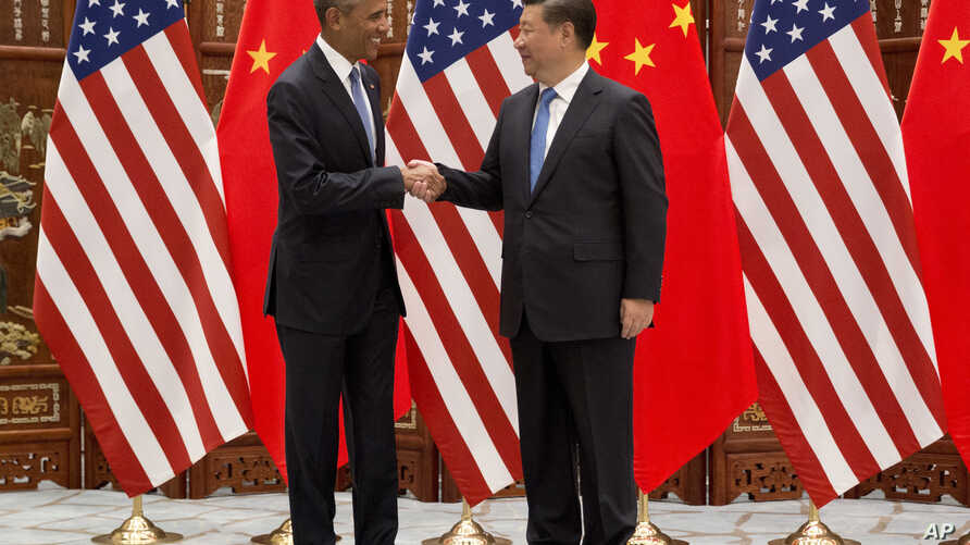 U.S. President Barack Obama, left, and Chinese President Xi Jinping shake hands before a bilateral meeting at Westlake State House in Hangzhou in eastern China's Zhejiang province, Sept. 3, 2016.