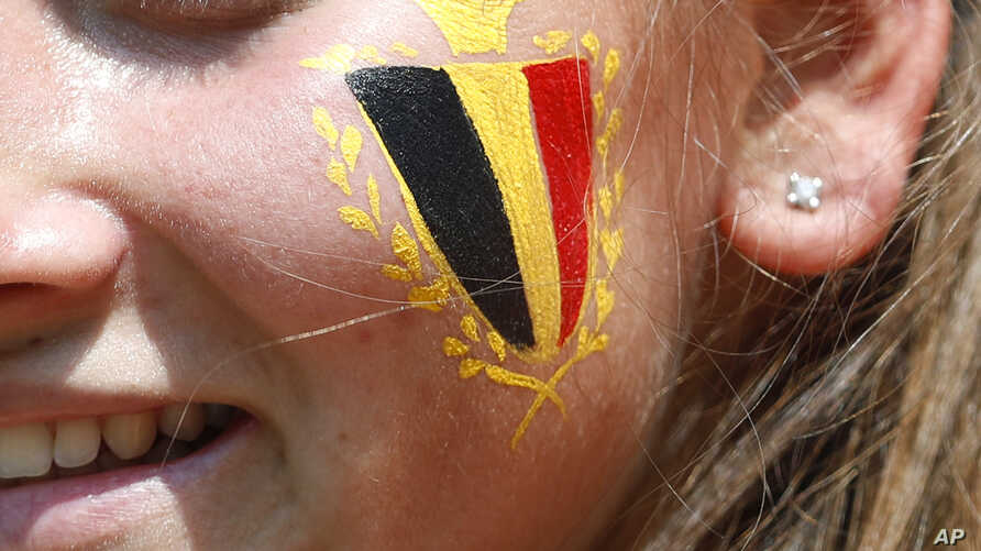 FILE - A Belgium fan waits for the group G match between Belgium and Tunisia at the 2018 soccer World Cup in the Spartak Stadium in Moscow, Russia, June 23, 2018.