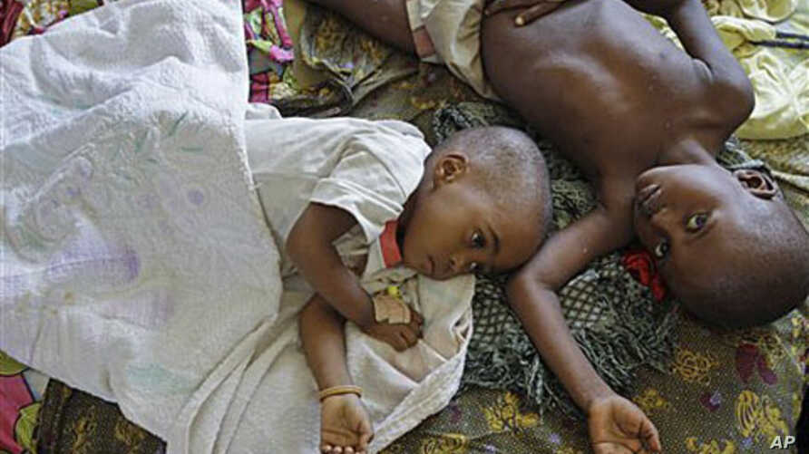 Two children with malaria rest at the local hospital in the small village of Walikale, Congo, September 19, 2010 (file photo)