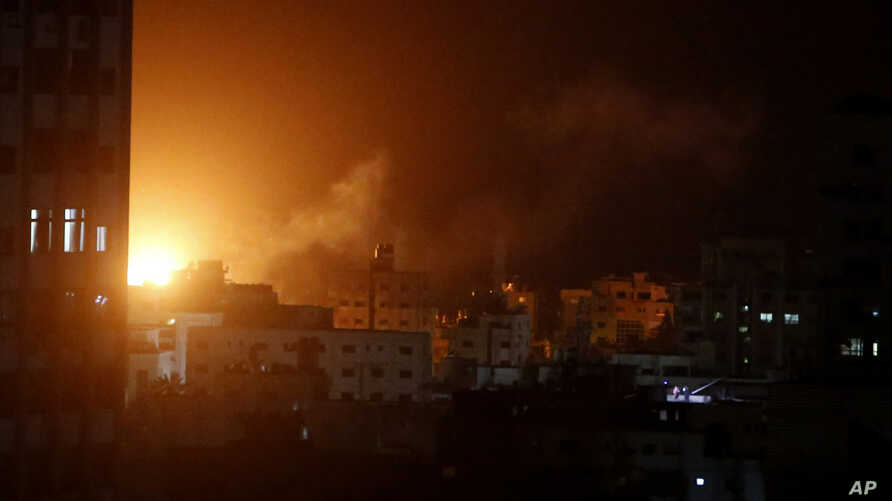 An explosion caused by Israeli airstrikes is seen from Hamas security building in Gaza City, March 25, 2019.