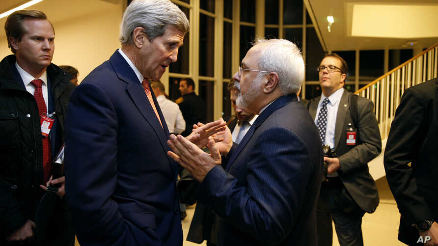 FILE - In this Jan. 16, 2016, photo, Secretary of State John Kerry talks with Iranian Foreign Minister Mohammad Javad Zarif in Vienna, after the International Atomic Energy Agency verified that Iran has met all conditions under the nuclear deal.