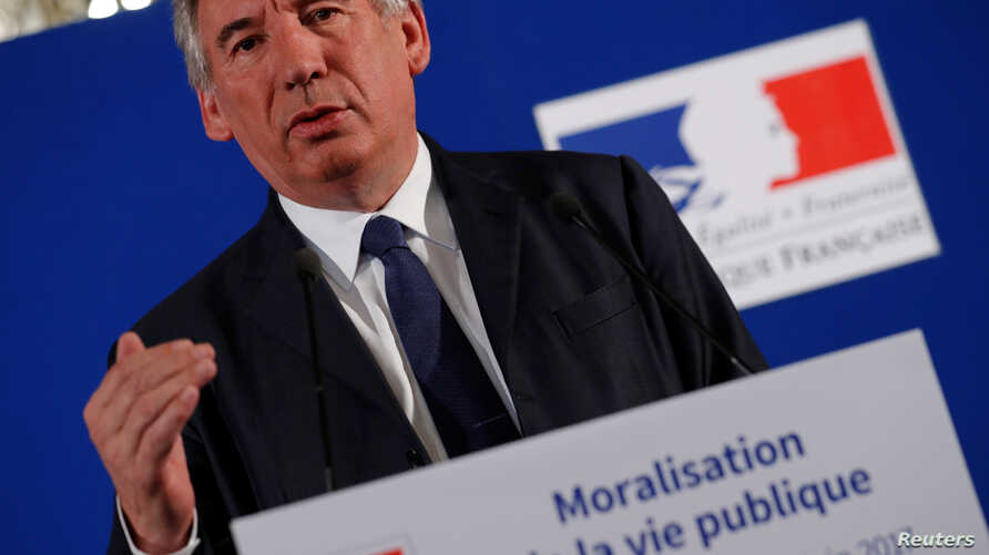 FILE - French Justice Minister Francois Bayrou presents a bill on ethics for public office holders at the ministry in Paris, France, June 1, 2017.