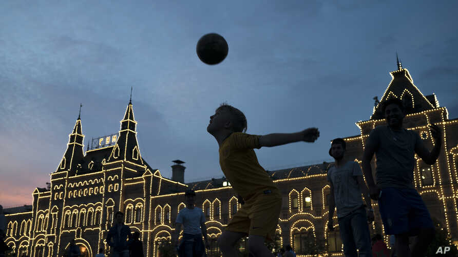People play soccer at the Red Square during the 2018 soccer World Cup in Moscow, Russia, June 19, 2018.