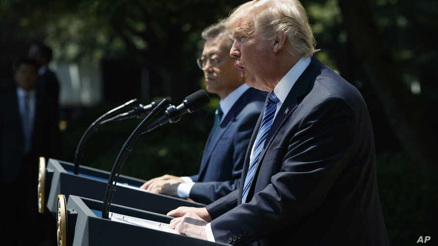 President Donald Trump, accompanied by South Korean President Moon Jae-in, speaks in the Rose Garden of the White House in Washington, June 30, 2017.