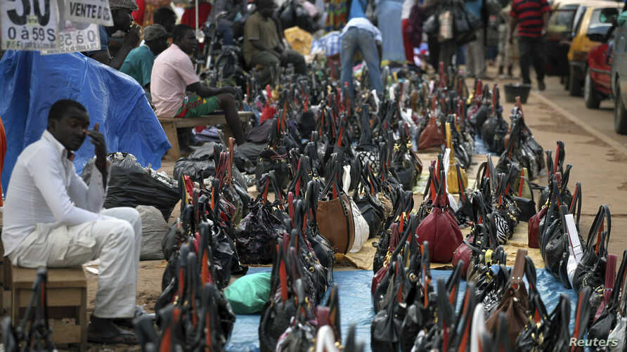 FILE - Bags are arranged for sale along a road at the Mokolo main market in Yaounde, the capital of Cameroon.