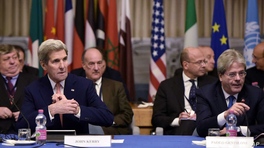 U.S. Secretary of State John Kerry, front left, and Italy's Foreign Minister Paolo Gentiloni, front right, take part in an international conference on Libya at the Ministry of Foreign Affairs in Rome, Dec. 13, 2015.