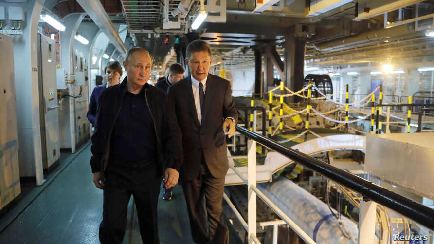 Russian President Vladimir Putin and Gazprom Chief Executive Alexei Miller inspect the work on the Turkish Stream gas pipeline project aboard the Pioneering Spirit pipeline-laying ship in the Black Sea near Anapa, Russia, June 23, 2017.