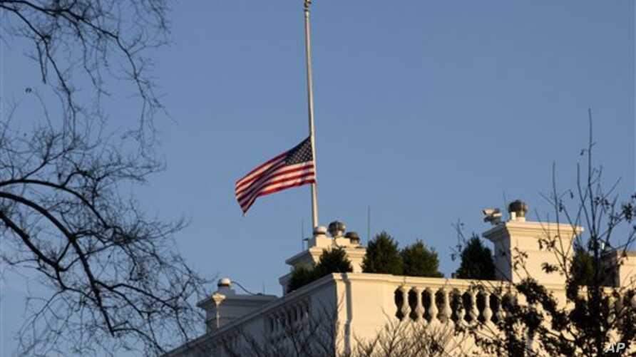 An American flag flies at half-staff in honor of the Connecticut elementary school shooting victims, over the White House in Washington, December 14, 2012.