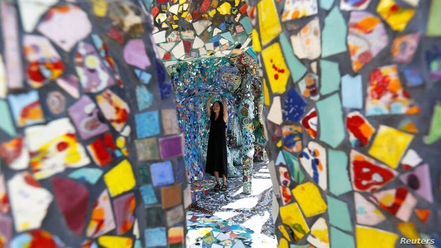 A visitor views the work of artists Gonzalo Duran and Cheri Pann at their Mosaic Tile House in Venice, California, Aug. 26, 2016.