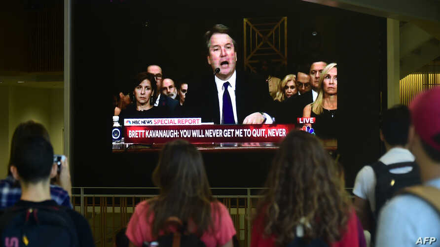 Students at the University of Southern California watch a live telecast of the testimony from Brett Kavanaugh concerning sexual assault allegations from Christine Blasey Ford, Sept. 27, 2018, at the Annenberg School for Communications and Journalism