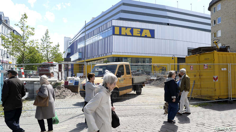FILE - People walk past IKEA's first city center store in Hamburg, Germany.