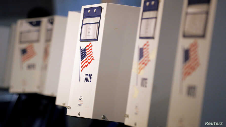 FILE -- Voting booths are ready for the New York primary elections at a polling station in the Brooklyn borough of New York City, U.S., April 19, 2016. U.S. voters go to the polls November 8 to elect a new president and members of Congress.