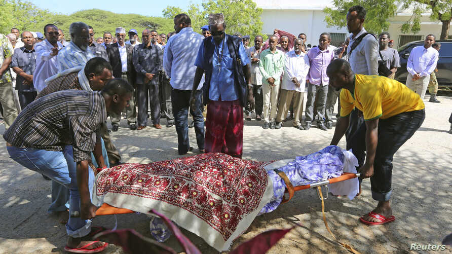 Members of the parliament and relatives carry the body of slain legislator Mohamed Mohamud Hayd who was shot dead in the Hamarweyne district of Mogadishu, Somalia, July 3, 2014.