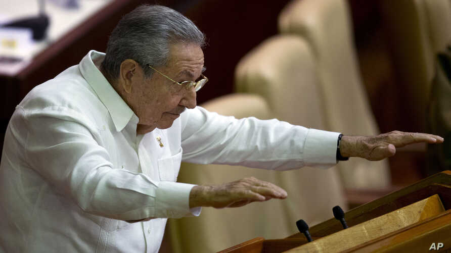 Cuban President Raul Castro gestures to lawmakers during the closing of the legislative session at the National Assembly in Havana, Dec. 20, 2014.