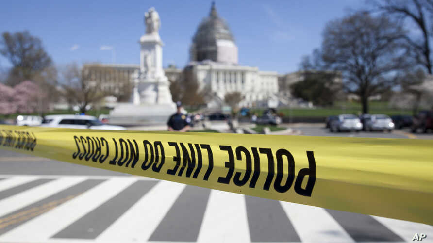 The north front of the U.S. Capitol in Washington is locked down after a shooting, April 11, 2015.