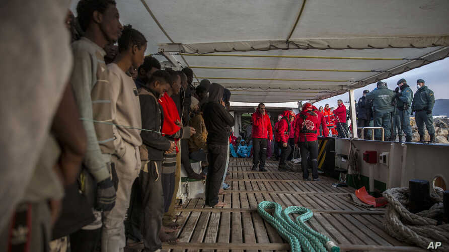 Migrants gather on the deck of the Spanish NGO Proactiva Open Arms rescue vessel after being rescued in the central Mediterranean sea Dec. 21, 2018, before disembarking in the port of Crinavis in Spain, Dec. 28, 2018.