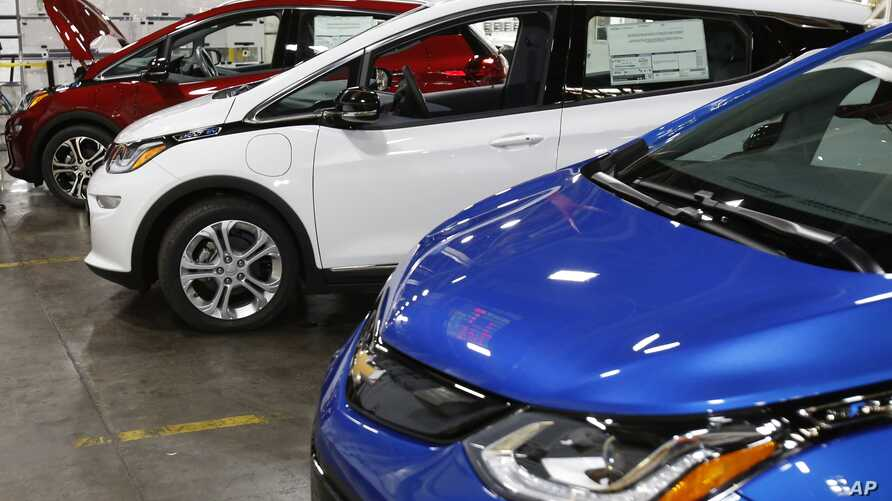 FILE - Several Chevrolet Bolt EV vehicles are shown during a tour of the General Motors Orion Assembly plant in Orion Township, Michigan, Nov. 4, 2016.