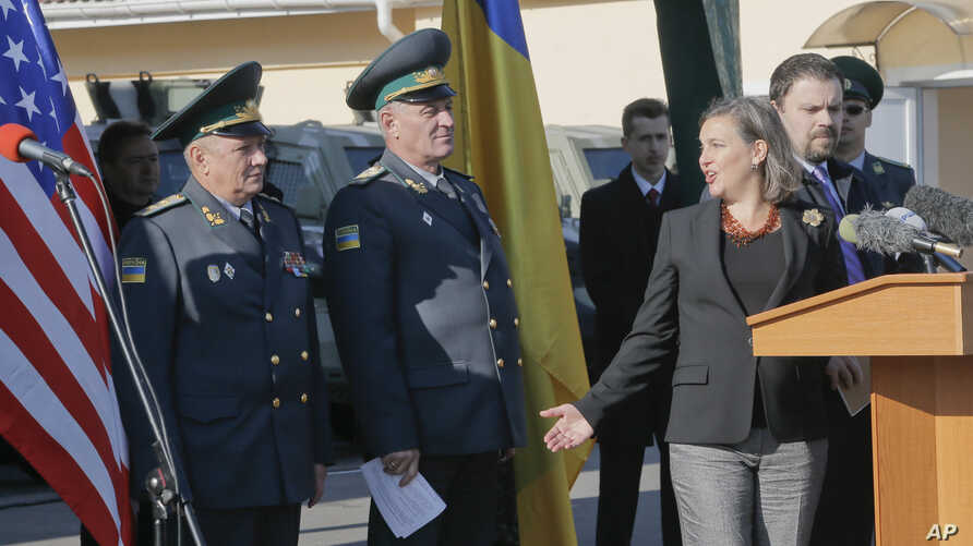 Assistant Secretary for European and Eurasian Affairs Victoria Nuland, second right, talks with  Ukrainian border guard  generals during her visit in a State Border Guard Service in Kiev, Ukraine, Oct. 8, 2014.