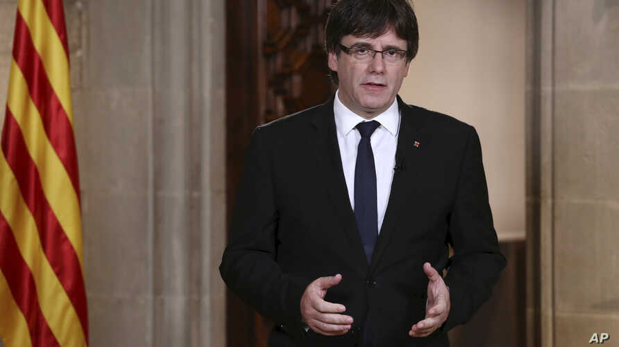 Catalan President Carles Puigdemont speaks in Barcelona, Spain, on Oct. 4, 2017. On Oct. 9, 2017, Puigdemont, asked Catalan leaders to back down in their  support of an independence referendum.